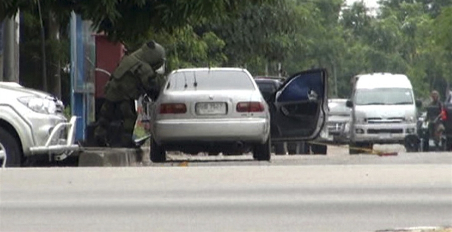potd1 Photo of the Day: As Bomb Expert Inspects, Explosion Rips Car Apart in Thailand