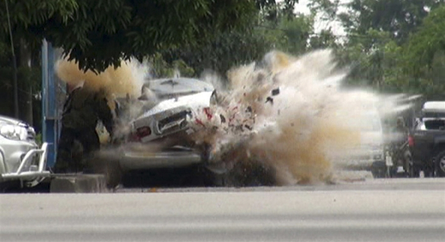 potd2 Photo of the Day: As Bomb Expert Inspects, Explosion Rips Car Apart in Thailand