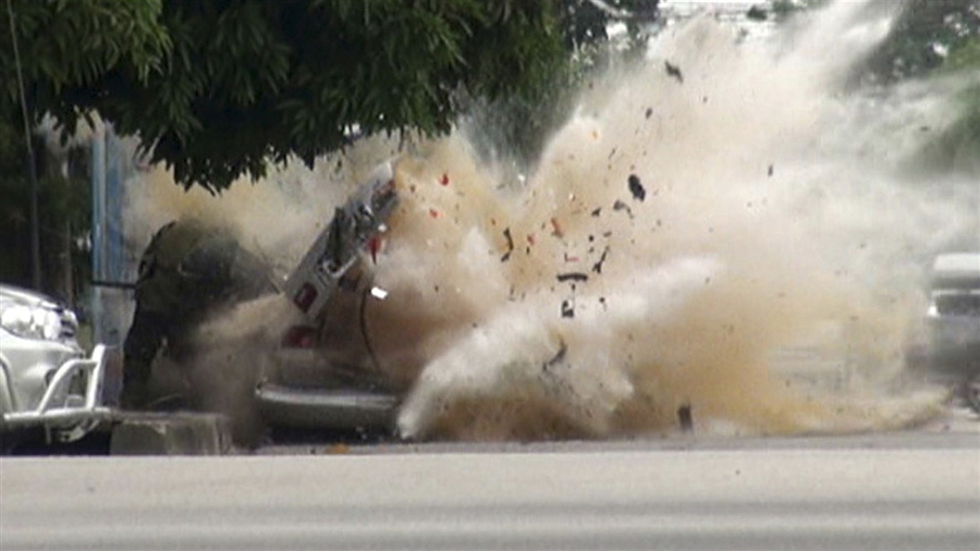 potd3 Photo of the Day: As Bomb Expert Inspects, Explosion Rips Car Apart in Thailand