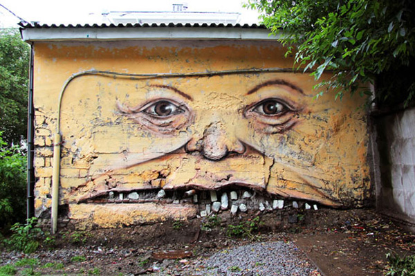 Russian Street Artist Makes Faces Out Of Old Buildings