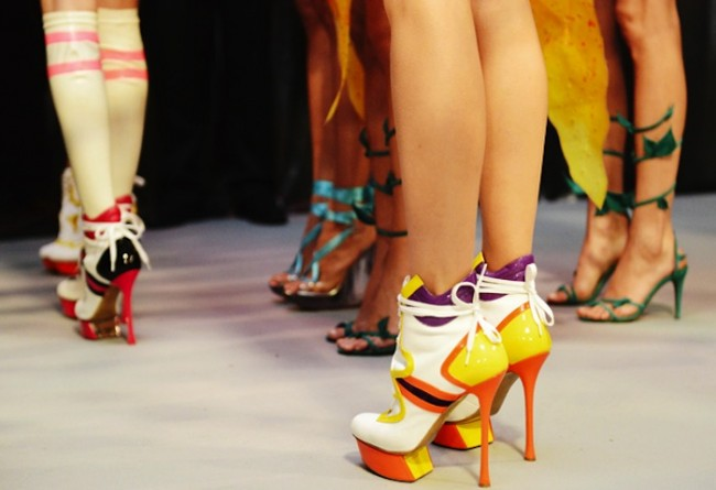 Photo taken on April 27, 2010, shows a model displaying a pair of shoes made in 1750. An antique shoes show was held in Hong Kong, on April 27, 2010