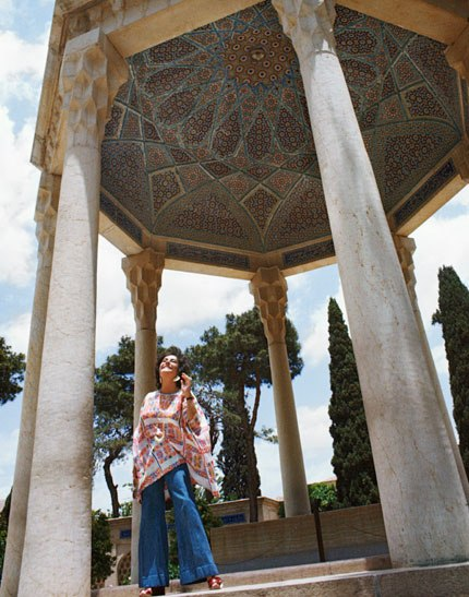 02 The actress beams upward at the sunlight in the city of Shiraz at the tomb of Hafez the controversial 14th century poet Photos of Elizabeth Taylor in Iran, 1976