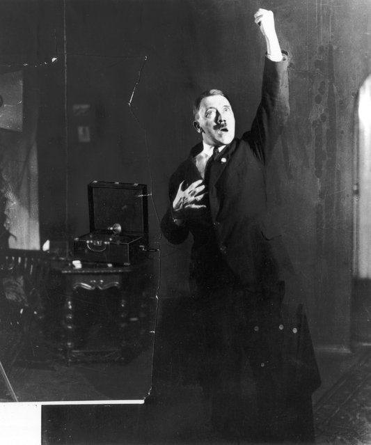 Adolf Hitler Posing to a Recording of His Own Speeches, 1925