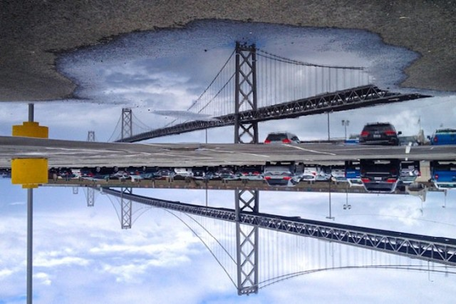 1401907136 1 640x426 Cityscapes in Puddle Reflections by Angela May Chen