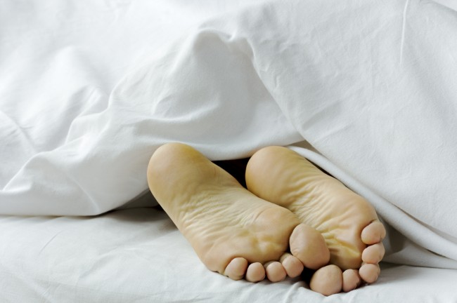 Feet hanging out iStock 000030213308Medium 650x432 Simplified Bedding: Lifes Complicated. Your bed shouldnt be.