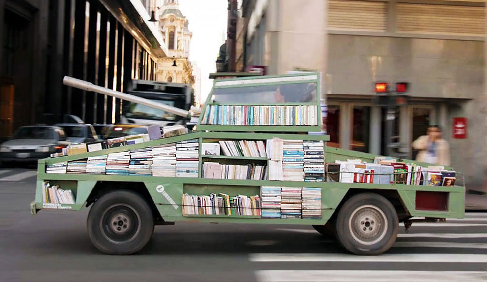 Artist Has Turned An Old Ford Falcon Into A Tank-Shaped Traveling Library