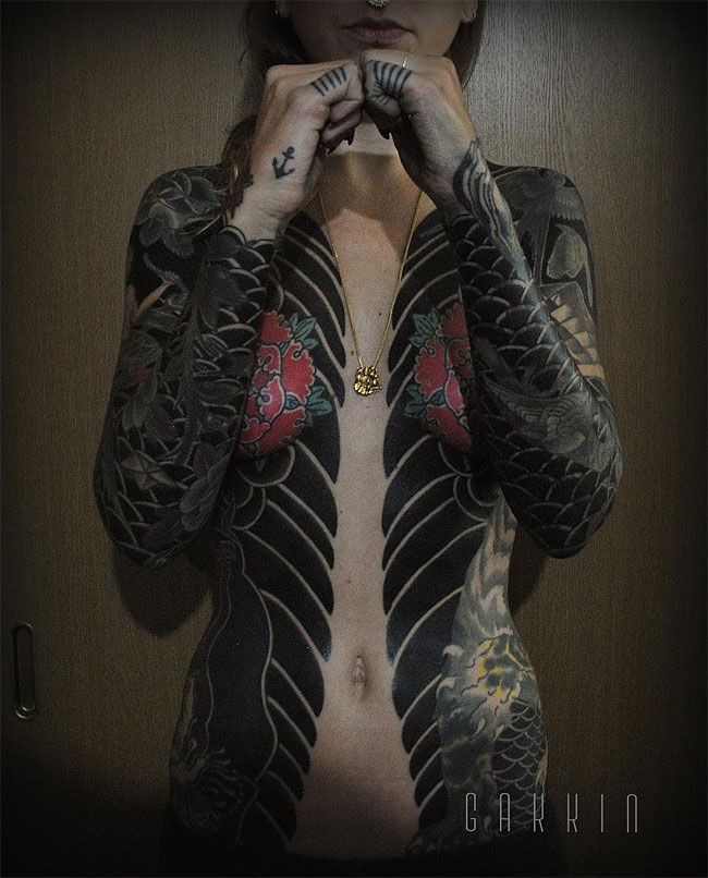 Bold japanese tattoos that looks like full body suits for Japanese body tattoo