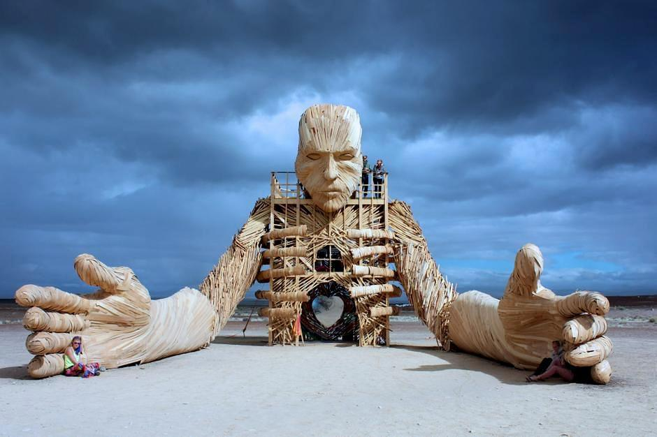 A Towering Wooden Sculpture By Daniel Popper Welcomes