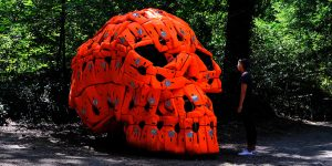 Pedro Pires Sculpts Large-Scale Skull Using 140 Life Vests And Rubber From A Refugee Dinghy